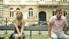 Relationship difficulties, couple sitting in park, steadicam shot HD Stock Footage