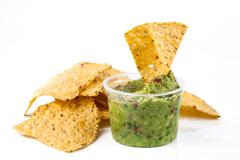 mexican corn chips and sauce - stock photo