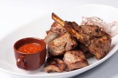 grilled meat with red sauce - stock photo