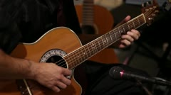 Man Playing Acustic Guitar into Microphone MS Stock Footage