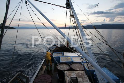 Stock photo of fishermans on the boat catch the fish