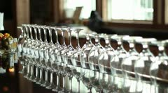 Pan Rack Focus Glasses Lined Up on Bar-top Stock Footage