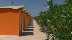Italy - changing room on the beach - stock footage