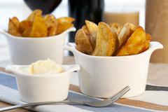 Patatas bravas with garlic mayonnaise Stock Photos