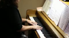 Slow Tilt Down Woman Playing Piano in a Church MS Stock Footage