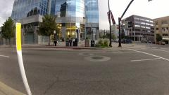 People crossing the street at a big business building.MP4 Stock Footage