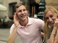 Portrait of young happy couple in the city, steadicam shot NTSC Stock Footage
