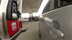 Driving away from a gas pump a the station.mp4 Stock Footage