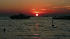 Boat passing over sunset Stock Footage