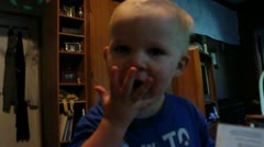 Boy licking hand Stock Footage