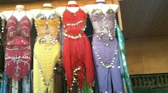 Morocco clothing market womens belly dance Stock Footage