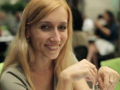 Young attractive woman smiling to camera in cafe, steadicam shot NTSC Stock Footage