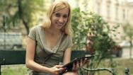 Happy young woman with tablet computer in the city, steadicam shot HD Stock Footage
