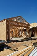 New home under construction with boards foreground Stock Photos