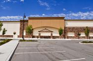 Stock Photo of shopping center with paking lot and blue sky