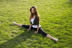 Girl Splits on Grass Stock Photos