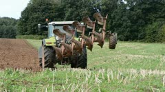 Tractor plowing on autumn tillage Stock Footage