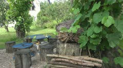 Stumps with wooden table in backyard Stock Footage