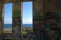 Ocean view from the window of abandoned power station Stock Photos