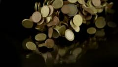 Euro coins falling on a black table Stock Footage