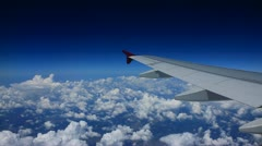 View From Airplane over clouds Stock Footage