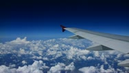 Stock Video Footage of View From Airplane over clouds