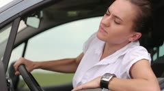 Frustrated young woman stuck in a traffic jam HD - stock footage