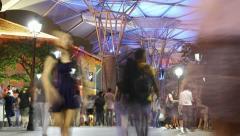 HD night time lapse of people walking at Singapore- Clarke Quay Bridge Stock Footage