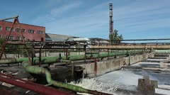 Big splashes of waste water in tank on water treatment plant - stock footage