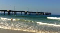 Boy Playing In Ocean Surf Venice Beach CA Stock Footage