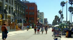 The Venice Beach Boardwalk With Tourists Walking Stock Footage