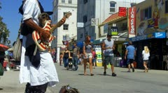 Stock Video Footage of Venice Beach Boardwalk Shops, Tourists, Street Musician