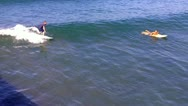 Venice Beach Surfer Rides Wave Past Waiting Surfer Stock Footage