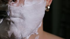 Man shaves close up Stock Footage