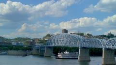 Cincinnati Riverboat passing under bridge along Ohio River Stock Footage