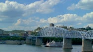 Stock Video Footage of Cincinnati Riverboat passing under bridge along Ohio River
