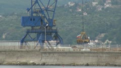 Crane working in port Stock Footage