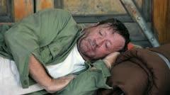 Homeless Man Tries to Sleep in Doorway Closeup - Model Released Stock Footage