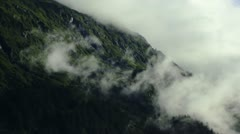Misty Clouds Overtaking Mountain Ridge Stock Footage