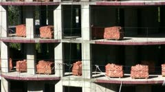 Pallets of bricks at a construction site Stock Footage