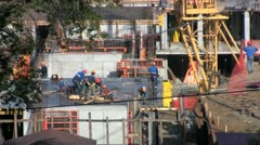 Workers at a construction site set formwork Stock Footage