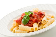 Stock Photo of pasta with tomato sauce and basil