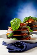 Stock Photo of aubergines with tomato sauce - parmigiana