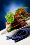 aubergines with tomato sauce - parmigiana - stock photo
