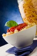 Pasta with tomato sauce on blue background Stock Photos