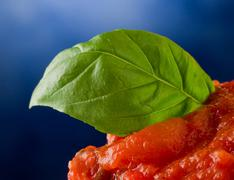 tomato sauce with basil leaf background - stock photo
