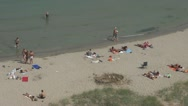 Stock Video Footage of People relaxing on the beach