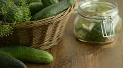 Spices like dill, chili, mustard seeds falling into a canning jar on a table. Stock Footage