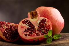 pomegranate in poor art style - stock photo