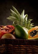 basket with tropical fruits - stock photo